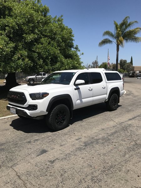 Check Out My 2017 Tacoma Trd Pro With New Snugtop Xtr Camper And Bfg Ko All Terrains Toyota Logo On Grill Is Red Too Now Also Filled In Black