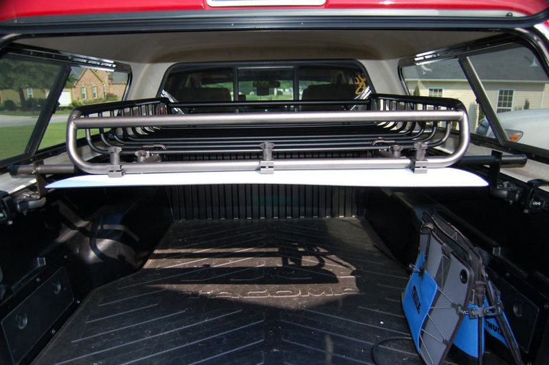 Tacoma shell close up of L2S Sport Rack Bracket holding Yakima basket.jpg