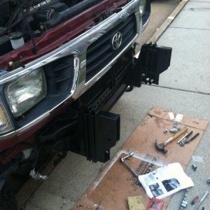 Mounting brackets in and cross member