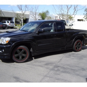 dirty truck with black wheels
