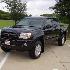 Black double cab sport front angle