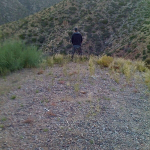 my buddy chris reliving him self off the side of the mountain!