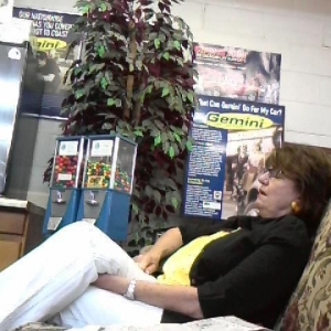 An old lady asleep next to me at the goodyear shop
