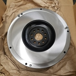 OEM (160k) flywheel got a makeover. Soaked in metal rescue for 2 days, 3 coats of primer, paint and clear, followed up with a trip to the machine shop