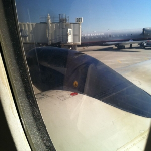I'm on a prop plane! These things are scary!
