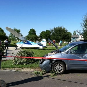 A small plane crashed into a Toyota Sienna.