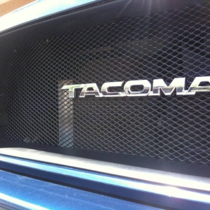 Satoshi with Tacoma badge