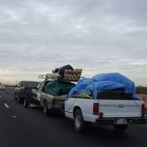 Truck towing a truck towing a truck trailer