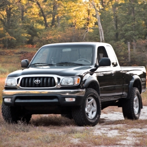 Black 1st gen tacoma in fall