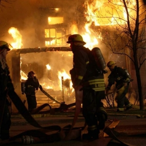 That's me in the center at a house fire involving two houses. First on