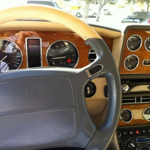 Less buttons. More wood and leather. Drives worse tho