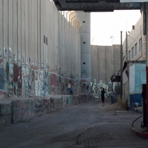 Here's an idea how tall the wall is that is prisoning the Palestinians