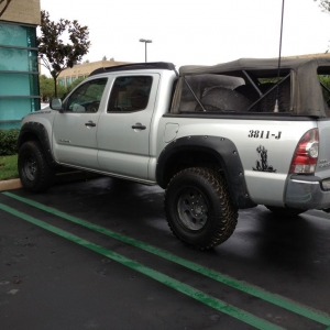265's. Smaller tire means no more rubbing.
