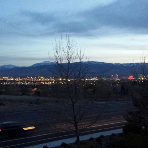 Out grilling on the balcony. Overlooking Reno city lights and sunset over t