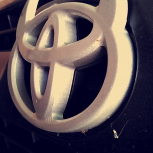 Toyota devil horns emblem mounted on factory 4runner grill