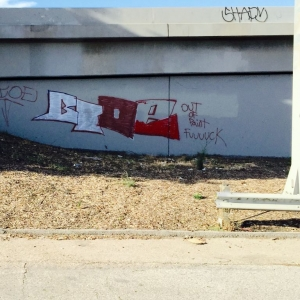 Graffiti on 5 Fwy southbound at Main St. exit in LA. Tagger has a sense of