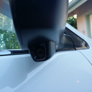 New hondas come with cameras on the right mirror that show a live feed of y